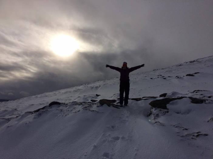 Natalie stands in the snow on Ben Rinnes